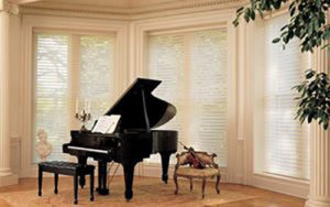 Black Piano with large a Window covered with white blinders