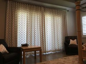 Large window covered with curtains