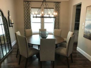 round dining table with candle chandelier
