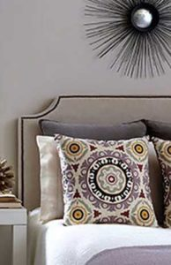 Madala design cushions on a bed