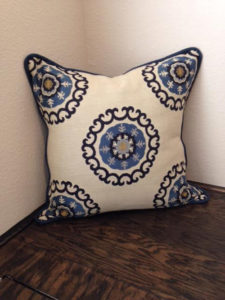 Image of a pillow made of Kravet fabric with pattern of blue and yellow