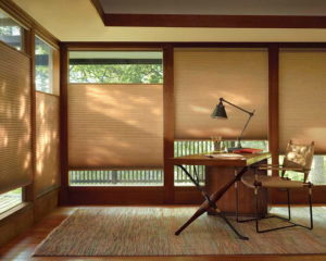 Earth tone interior in the living room with beige color shadings on the window