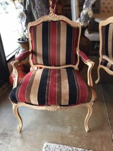 Wooden chair with striped fabric cushions