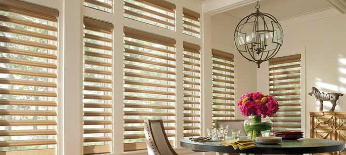 roman shade shutter windows in the dining area