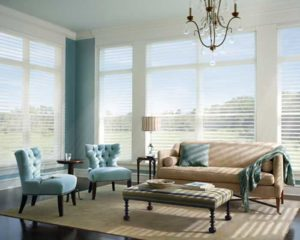 A living room with light blue furniture set