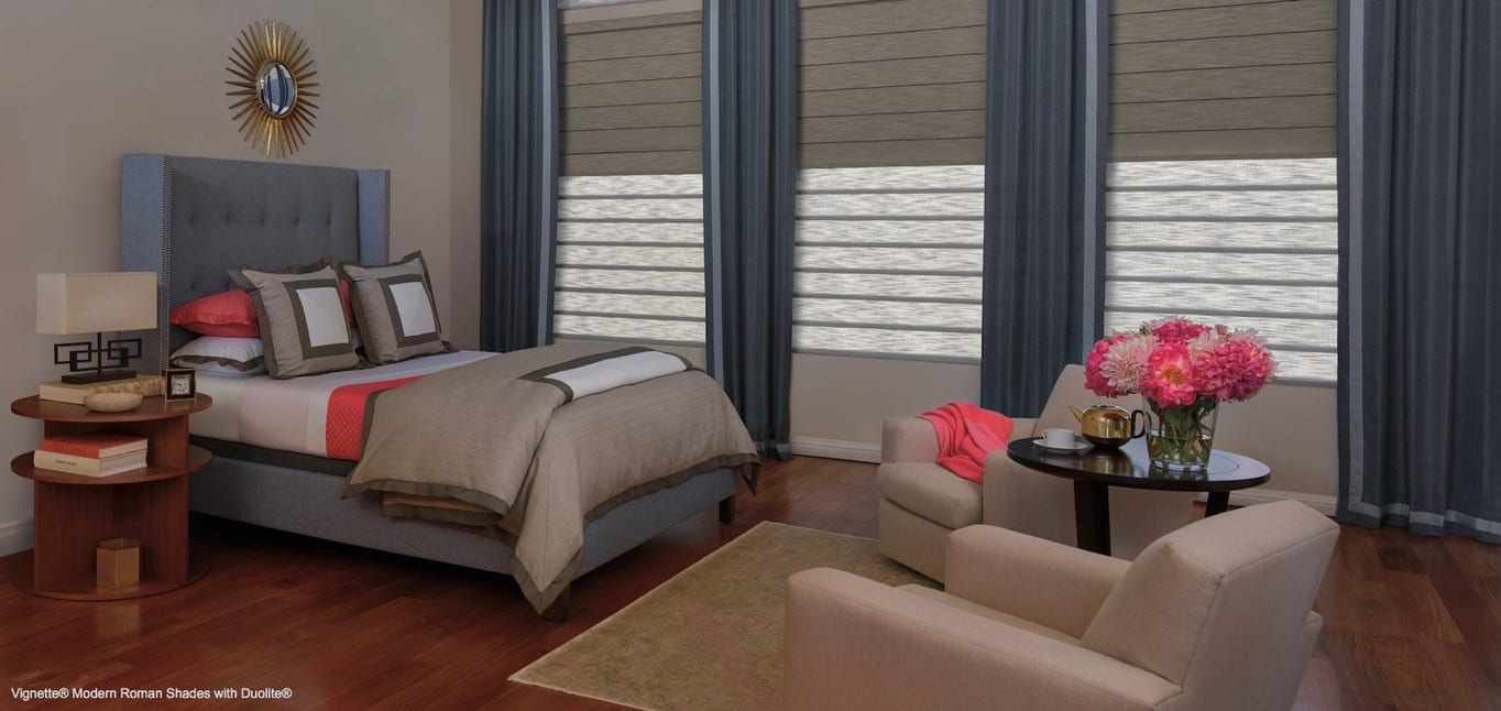 A bedroom with rose-colored accents. Shown with Vignette Modern Roman Shades, available at Read Design