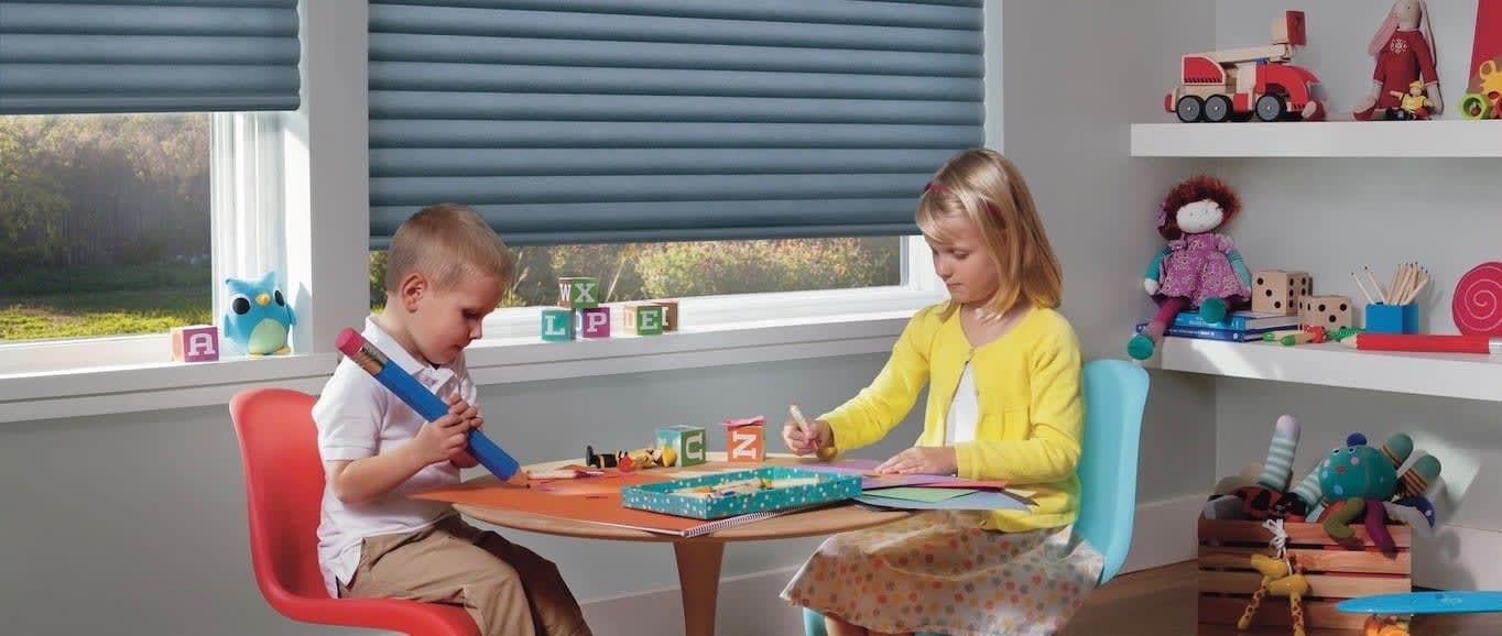 A kids room with activity table. Shown with Sonnette Cellular Roller Shades, available at Blind Depot.