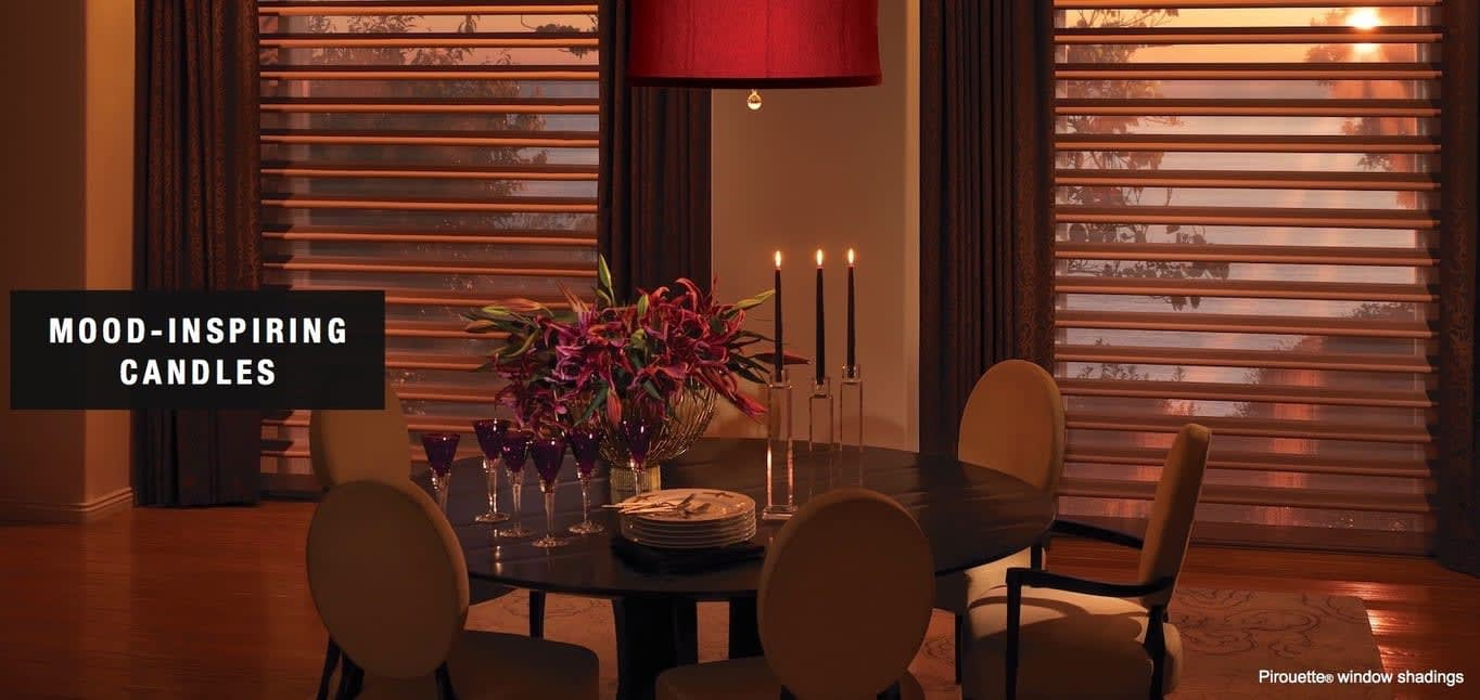 A dining room with mood-inspiring candles. Shown with Pirouette® window shadings, available at Read Design
