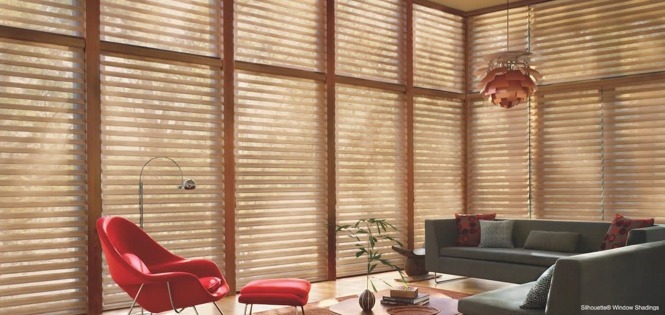 A stunning ceiling light in a living room. Shown with Silhouette Window Shadings, available at Read Design
